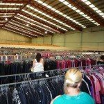 Clothes on rails in a warehouse